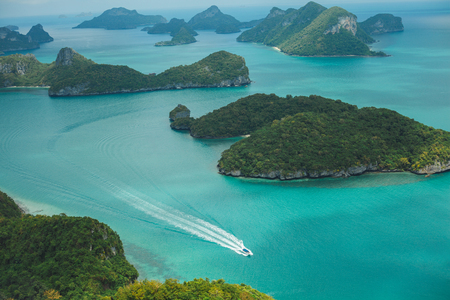 aerial view of boat and islands in ocean at Ang Thong National Park, Ko Samui, Thailand