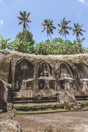 scenic view of ancient architecture of Temple Complex and Royal Tombs and green plants around, Bali, Indonesia Фото со стока