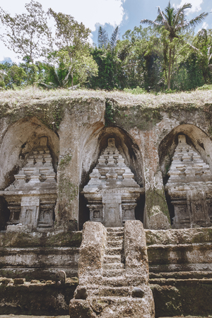 scenic view of ancient Temple Complex and Royal Tombs architecture and green plants around, Bali, Indonesia Фото со стока