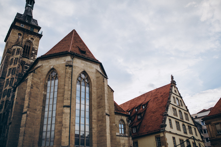 low angle view of historical buildings and cloudy sky in stuttgart city, germany
