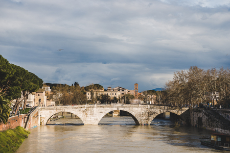 bridge over tiber river on cloudy day, Rome, Italy Stock Photo