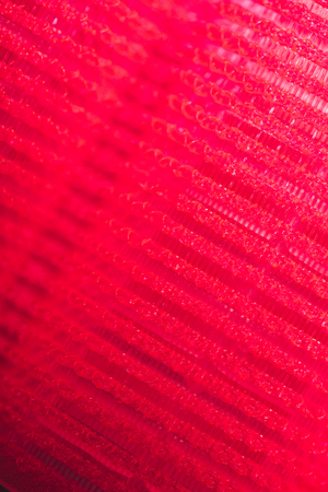 macro shot of red hair curler texture Фото со стока