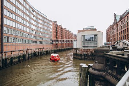HAMBURG, GERMANY - SEP 4, 2016: Urban scene with river and old warehouse city district in hamburg, germany Stock Photo