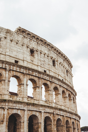 famous Colosseum ruins on cloudy day, Rome, Italy Banco de Imagens