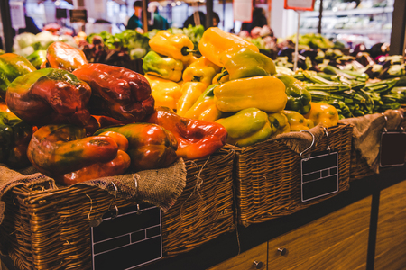 close-up shot of fresh bell peppers in baskets selling on farmers market, Rome, Italy Stock Photo