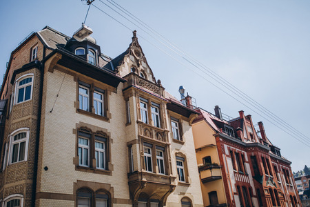 low angle view of buildings and clear sky in stuttgart city, germany