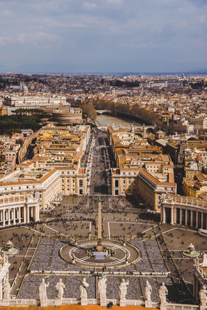 aerial view of St. Peters square with crowd of people, Vatican, Italy