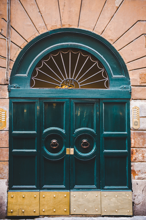 old green doors in building in Rome, Italy Stock Photo