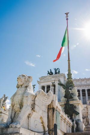 bottom view of beautiful Altare della Patria (Altar of the Fatherland) with italian flag, Rome, Italy Stock Photo