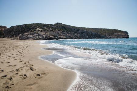footprints on sandy beach and beautiful sea waves, patara beach, turkey