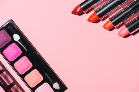 top view of different makeup supplies on pink surface Standard-Bild - 106614589