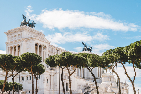 beautiful Altare della Patria (Altar of the Fatherland) with trees on foreground, Rome, Italy 版權商用圖片