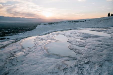majestic landscape with white geological formations at sunrise, pamukkale, turkey Stock Photo