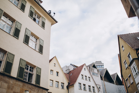 low angle view of buildings and cloudy sky in stuttgart city, germany