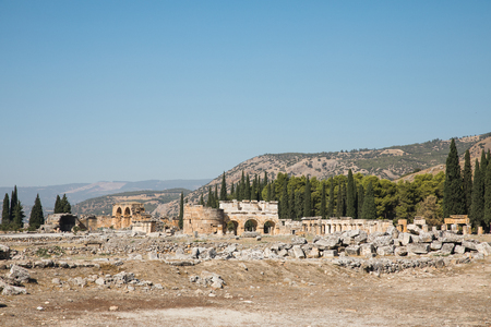 beautiful ancient architecture and mountains behind in pamukkale, turkey