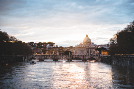st peters basilica and tiber river during beautiful sunrise in Rome, Italy