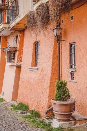 orange building in Castel Gandolfo, Rome suburb, Italy