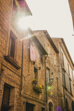 low angle view of buildings in sunlight in Orvieto, Rome suburb, Italy