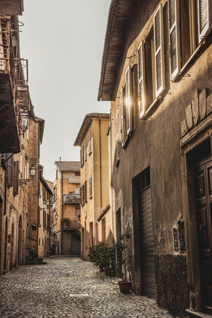 empty street and buildings with sunlight in Orvieto, Rome suburb, Italy