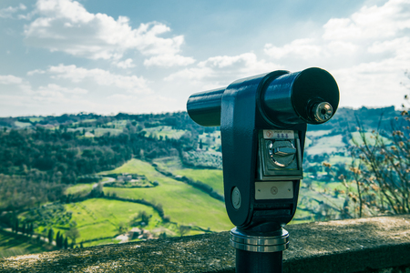 binoculars on sightseeing terrace and hills on background in Orvieto, Rome suburb, Italy Stock Photo