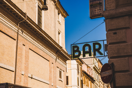 ROME, ITALY - 10 MARCH 2018: bar sign with ancient buildings on background