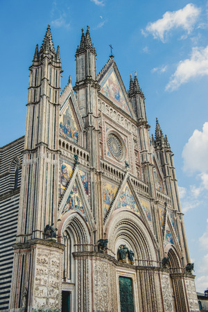 low angle view of old Orvieto Cathedral against blue sky in Orvieto, Rome suburb, Italy