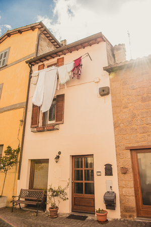 clothes drying outside building in Orvieto, Rome suburb, Italy