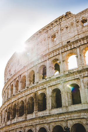 ancient beautiful Colosseum ruins with sunshine in Rome, Italy