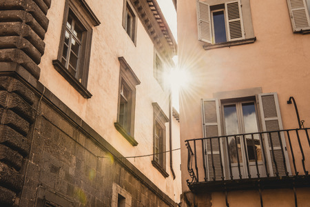 sunlight between buildings in Orvieto, Rome suburb, Italy