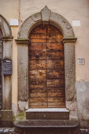 old wooden brown doors in Castel Gandolfo, Rome suburb, Italy