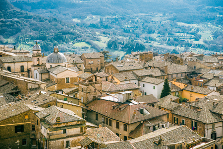 aerial view of buildings and hills with trees in Orvieto, Rome suburb, Italy Stock Photo