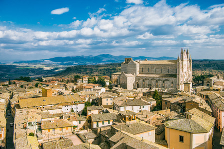 aerial view of Orvieto Cathedral and buildings with mountains on background in Orvieto, Rome suburb, Italy Stock Photo