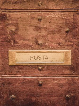 post signboard on doors in Orvieto, Rome suburb, Italy