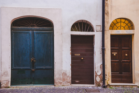 three wooden doors in buildings in Rome, Italy