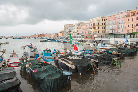 ANZIO, ITALY - 19 MARCH 2018: boats in harbour of Anzio on cloudy day, Italy