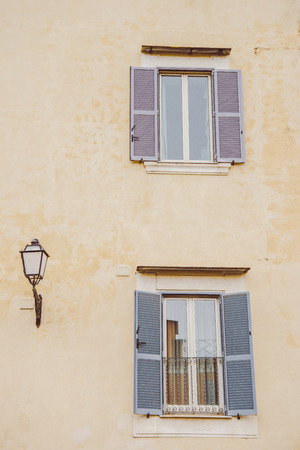 windows with open shutters in Castel Gandolfo, Rome suburb, Italy