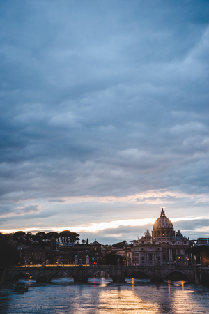 st peters basilica and tiber river during sunset in Rome, Italy Stock Photo