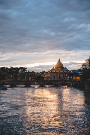 st peters basilica and tiber river during sunrise in Rome, Italy
