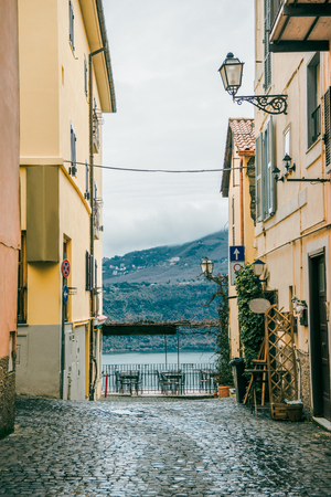 view on alban hills between buildings in Castel Gandolfo, Rome suburb, Italy Фото со стока