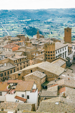 aerial view of buildings roofs and green hills in Orvieto, Rome suburb, Italy
