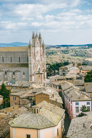 aerial view of ancient historical Orvieto Cathedral and roofs of buildings in Orvieto, Rome suburb, Italy Stock Photo