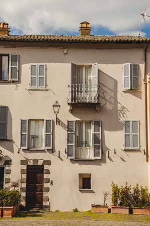 exterior of building with windows and balcony in Orvieto, Rome suburb, Italy
