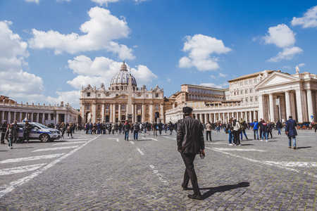 ROME, ITALY - 10 MARCH 2018: people walking by St. Peters square