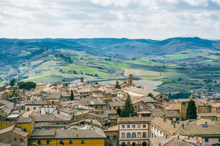 aerial view of buildings and green hills in Orvieto, Rome suburb, Italy