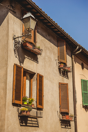 windows with shutters in Orvieto, Rome suburb, Italy Фото со стока