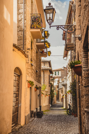 narrow street and old buildings in Orvieto, Rome suburb, Italy Stock Photo