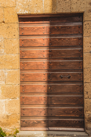 shadow on old wooden doors in Orvieto, Rome suburb, Italy Stock Photo