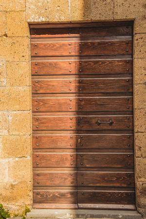 shadow on old wooden doors in Orvieto, Rome suburb, Italy Фото со стока