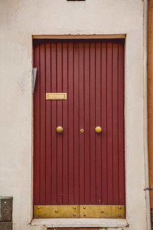 wooden red doors in Castel Gandolfo, Rome suburb, Italy Фото со стока
