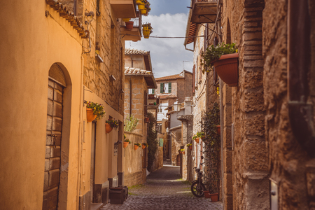 narrow street and ancient buildings in Orvieto, Rome suburb, Italy